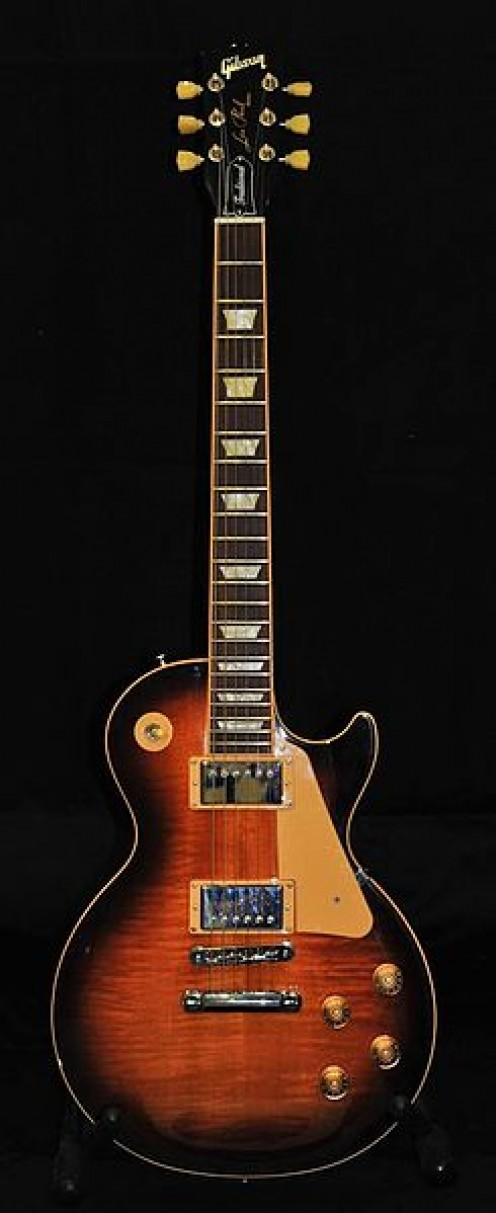 The Gibson Les Paul is made with a mahogany neck, and a mahogany body with a maple cap. Check out the quality of the maple on this one. Nice! (Image: John Clift [CC-BY-2.0] via wikimedia commons)