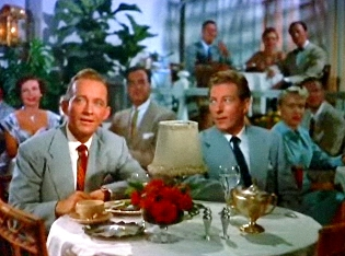 Bing Crosby and Danny Kaye notice their love interests in White Christmas.