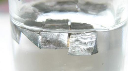 Lithium is the lightest metal, shown here floating in mineral oil.