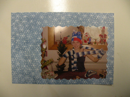 Adhere photo to cardstock