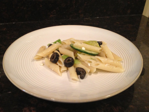 Greek Pasta Salad includes cucumbers, olives, green peppers, peperoncini, feta cheese and penne pasta