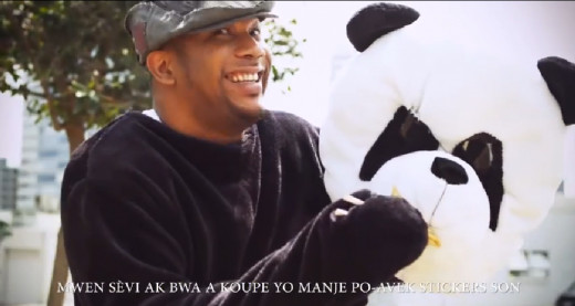 Patrice Wilson, co-founder of Ark Music Factory. No, seriously, he is in a panda costume.