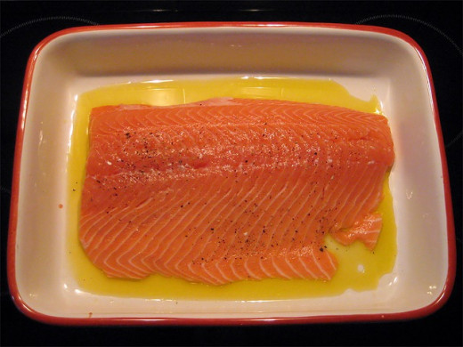 Salmon ready for baking in butter. You can bake salmon filets and use the flaked meat instad of canned salmon.