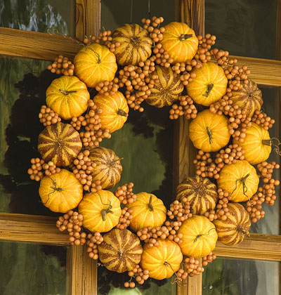 This fall wreath was made with real pumpkins.