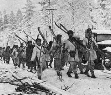 Finnish troops marching on Raate-Road. On the road are visible remnants of the Russian 163rd Division.