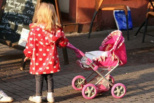 LIttle girl and her 'babe' - on a downtown street in Ettlingen, Germany