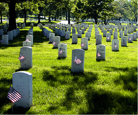 John Kennedy's body is buried with other veterans at Arlington National Cemetery.