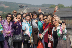 A smiling, happy tour group posing for us near Ping Yao