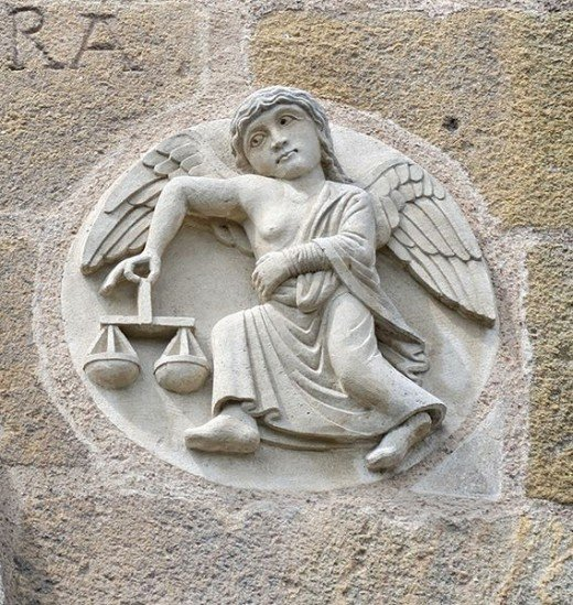 Libra zodiac sign on the Saint-Austremoine Issoire Church facade in Auvergne, France