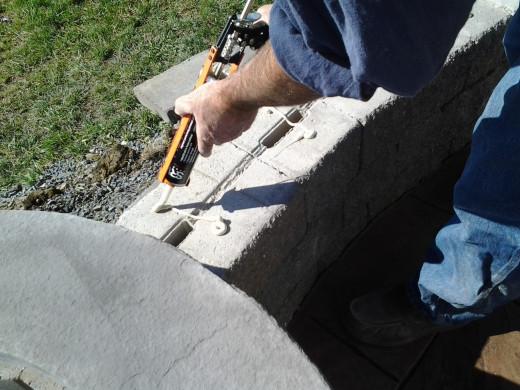 Using masonry glue.