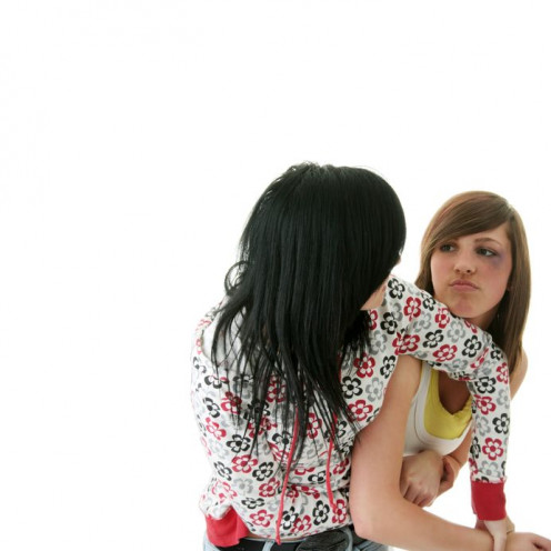 Two teenage girls fighting.