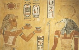Thoth the Ibis God is pictured here to the right, with a solar disk on his head and a scepter in hand.