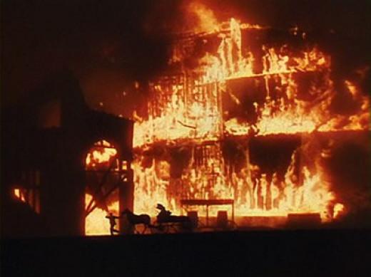 Rhett, Scarlett and their company escape from a burning Atlanta