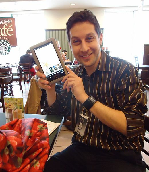 A salesman demonstrates a Nook tablet at Barnes and Noble bookstore.