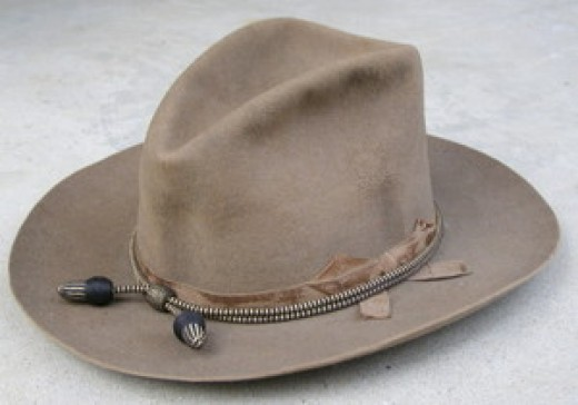 This was the most common hat worn on the plains even before the 1880s. Officers often continued to wear dark blue hats, while the rank and file in the Army all wore this color and style of hat until the 1900s.