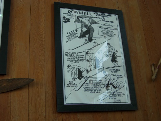 A display of vintage ski equipment and posters teaching how to ski.