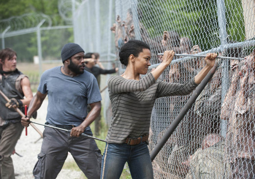 Daryl, Tyreese, and Sasha killing walkers at the fence outside the prison in Season 4 Episode 2