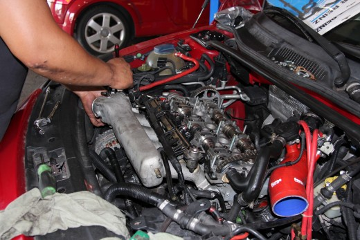 An engine with over 220,000 miles undergoing extensive servicing.  Important maintenance is often mileage-based and difficult to stick to with inaccurate, tampered odometers.
