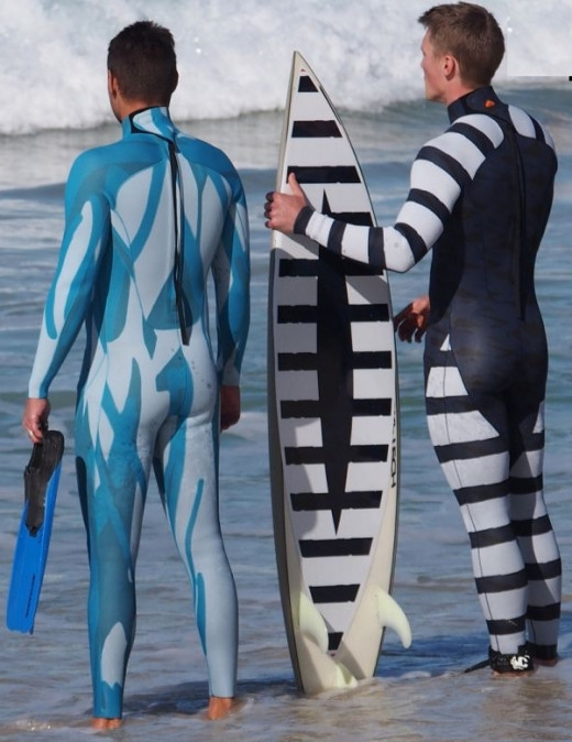 Stealth wetsuit designs either blend into the water scape or mimic the warning colors and patterns used by fish. They also 'break' the outline of objects and make them less visible in this way.