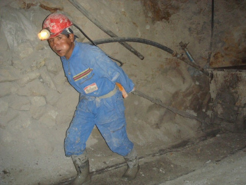 Potosi mine worker with a mouthfull of  coca leaves