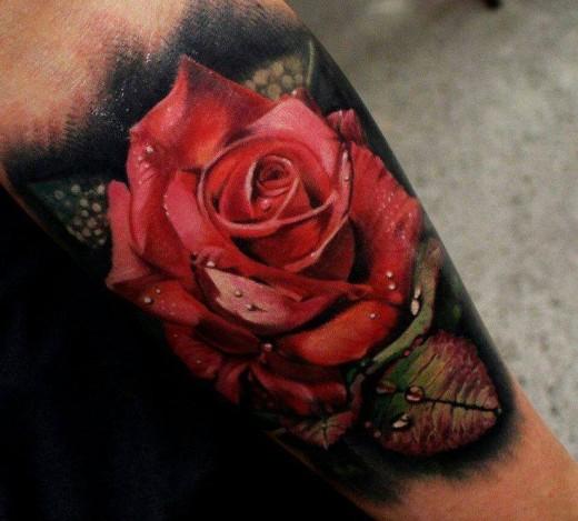 Rose tattoo on underarm