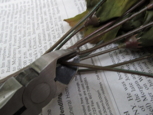 Use wire cutters to remove flower and /or foliage stems from artificial 'bush' or 'garland'.