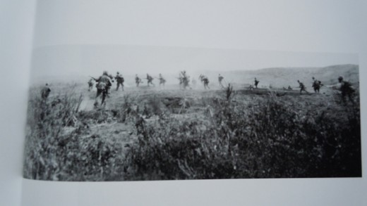 F Company, 2/26, 5th Division, USMC advances on Iwo Jima. Pictured from behind.
