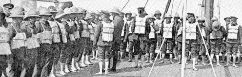 Lifebelt parade aboard a British troopship in the Dardanelles, an important part of the daily duty in waters that may be patrolled by enemy submarines.