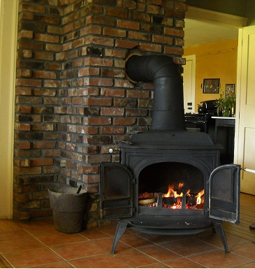 The fire in the living room woodstove heats the entire house. Throughout the summer we cut, split and stack wood so that the woodshed is full. All winter long the fire burns keeping us toasty through the cold Vermont winter.