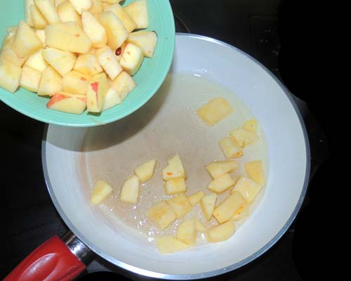 Saute apple chunks in sizzling veggie oil