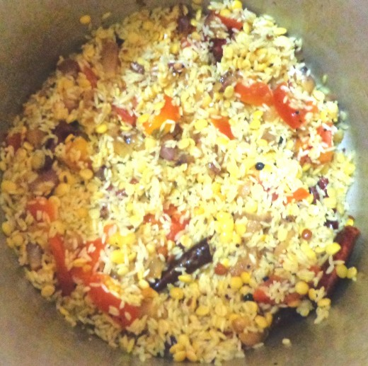 Drained rice and dal sauteed with existing ingredients