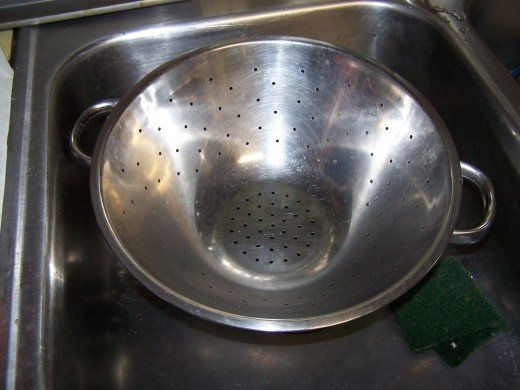Here I have my colander in the sink ready to drain the cooked pasta.