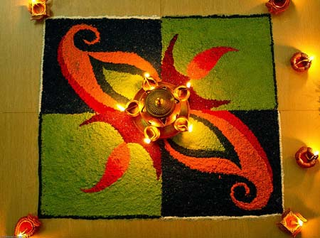 The materials used for making rangoli may differ depending on the designer's desire. But the most commonly used material is colored rice flour or powder. Rangolis are often adorned with small lamps and candles.