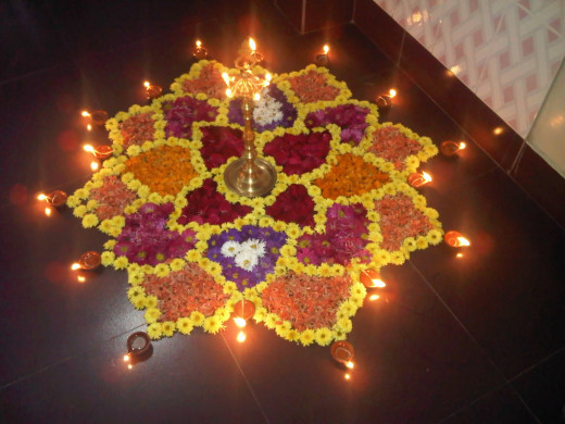 Sometimes, people use flowers in rangoli. This type of rangoli is called pookalam in Kerala.