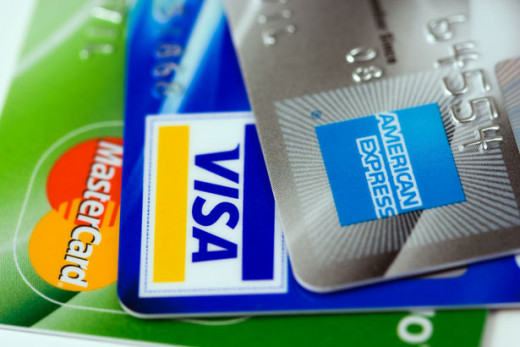 Image of three credit cards, courtesy of Peter Kratochvil on publicdomainpictures.com
