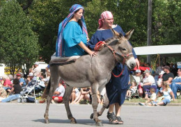 Christmas parade representing the journey to Bethlehem by Joseph and Mary