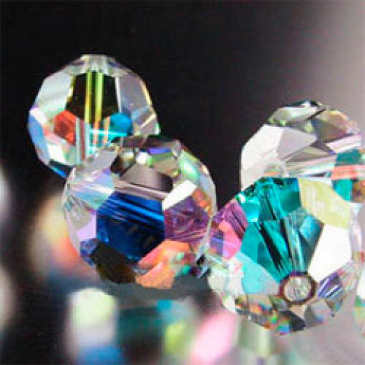 An example of AB coating on Swarovski crystal. This coating makes the crystal reflect rainbows in sunlight and is often used in jewelry and suncatchers.
