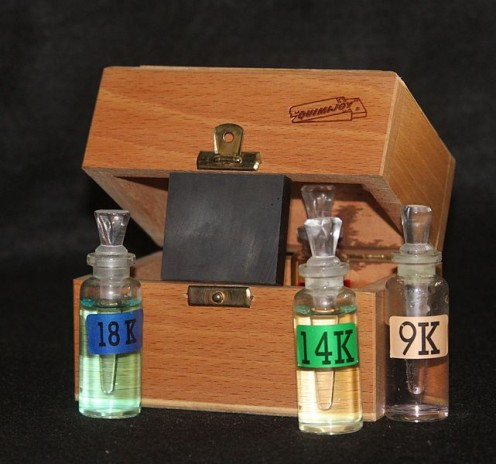 Assay tool kit with touchstone and acid vials.