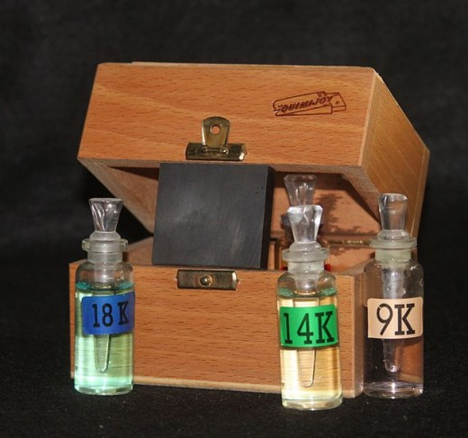 Assay tool kit with touchstone and acid vials. Used to test the karat rating of precious metals.
