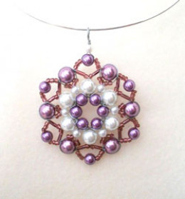 A purple beaded pendant using pearls in natural looking colours.