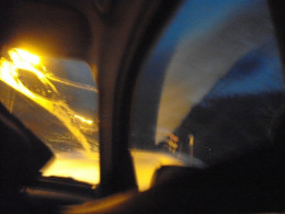 Sunlight reflecting in rear window of car