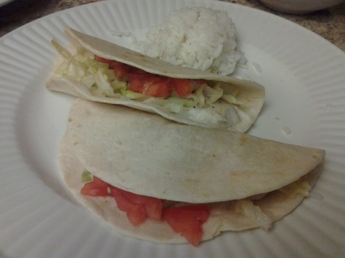 My 10 year old loves fish but not green onions, cilantro, or avocado.  I fill his tacos with tomatoes and lettuce and give him a half cup of rice to finish off his meal.