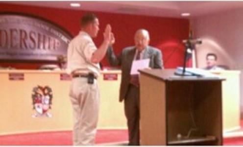 Craig Knapp taking the oath of office