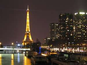 Eiffel tower in the distance at night
