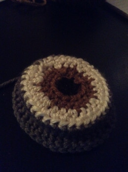 After crocheting the goggle part the finished eye should have the shape of a bottle cap.