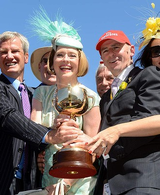 Happy trainer and owners receiving the cup.