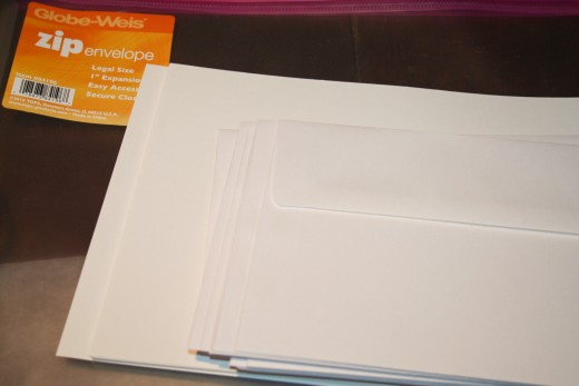 I keep pre-cut and folded cardstock card sets with envelopes in zippered plastic sleeves.  These card sets were purchased at Michael's Craft Store for around $10 for a set of 25 depending on size.