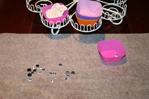 The set of silicone cupcake liners comes in handy when I'm working with multiple die cuts and embellishments.  I put all of my cut outs or gems in the cupcake liners while I work on my desk space.
