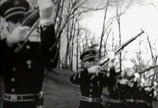 Three rifle volleys are fire at JFK's funeral,