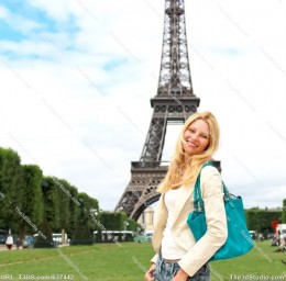 Beautiful girl by Eiffel Tower